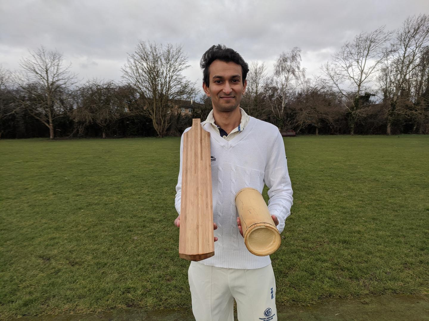 Dr. Darshil Shah with one of the prototype bamboo cricket bats and a length of the bamboo used to make it