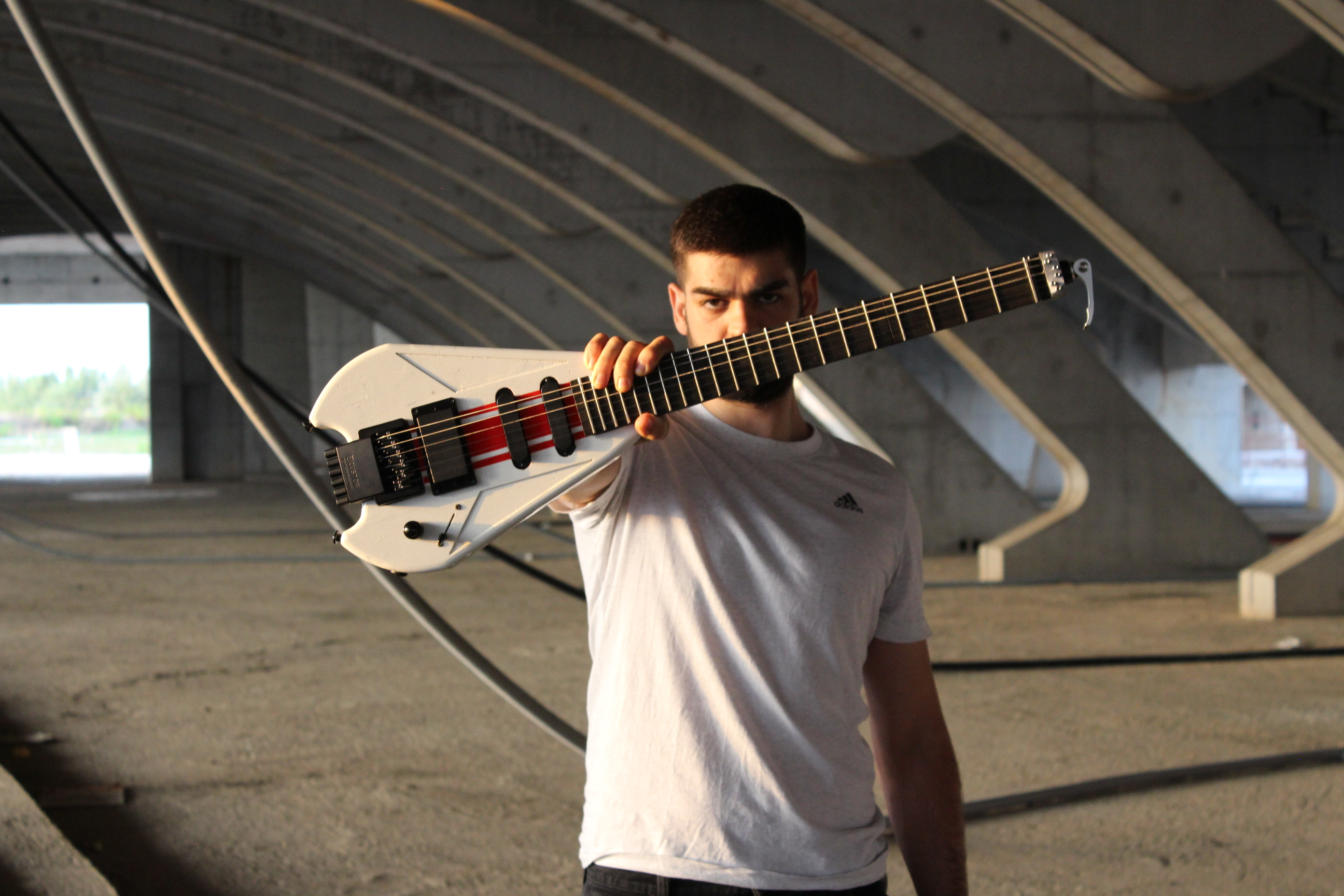 Travel guitar breaks into three for transport