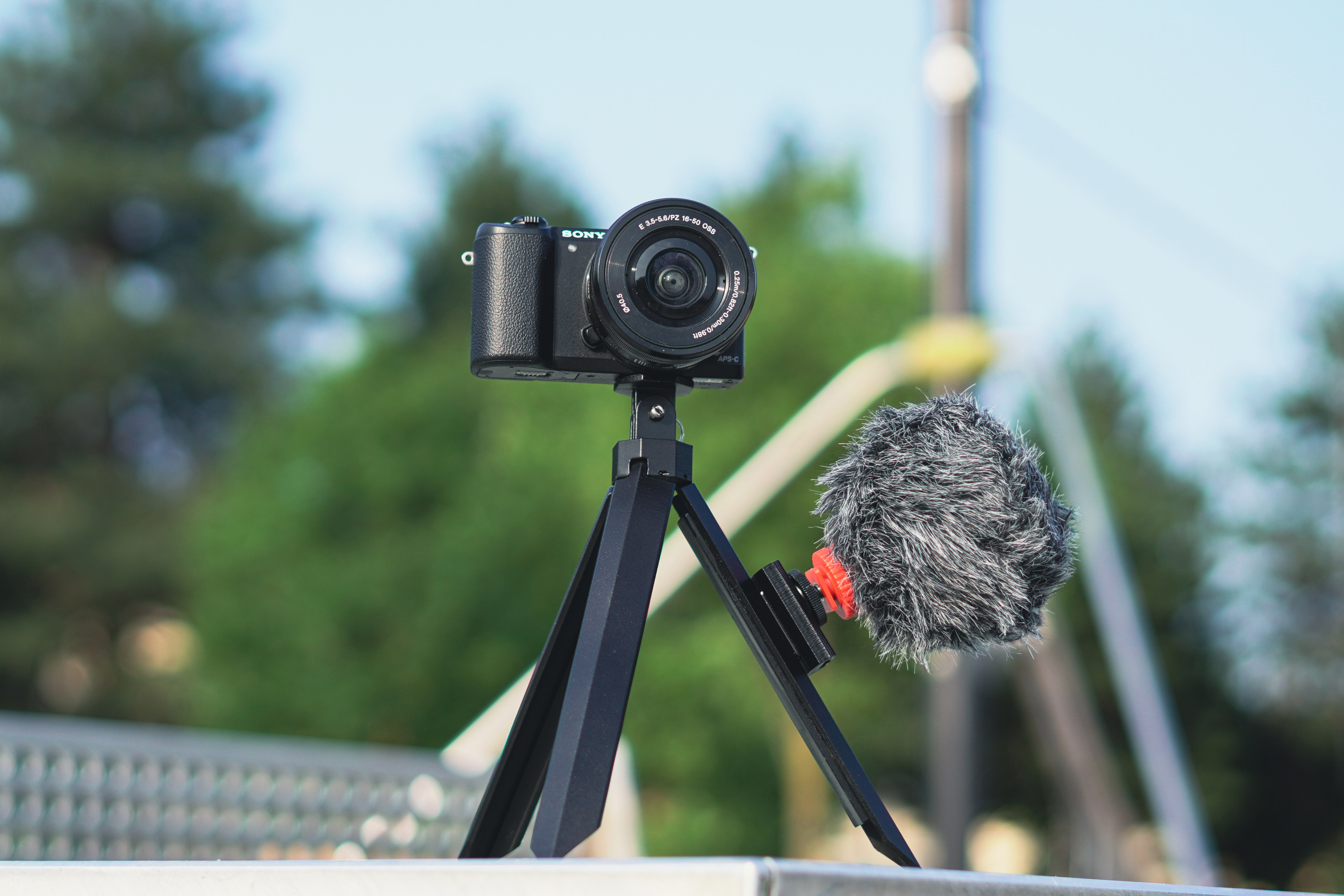 Utilizing an optional magnetic cold shoe bracket, camera accessories such as microphones can be stuck onto the Hookpod Pro's magnetic leg