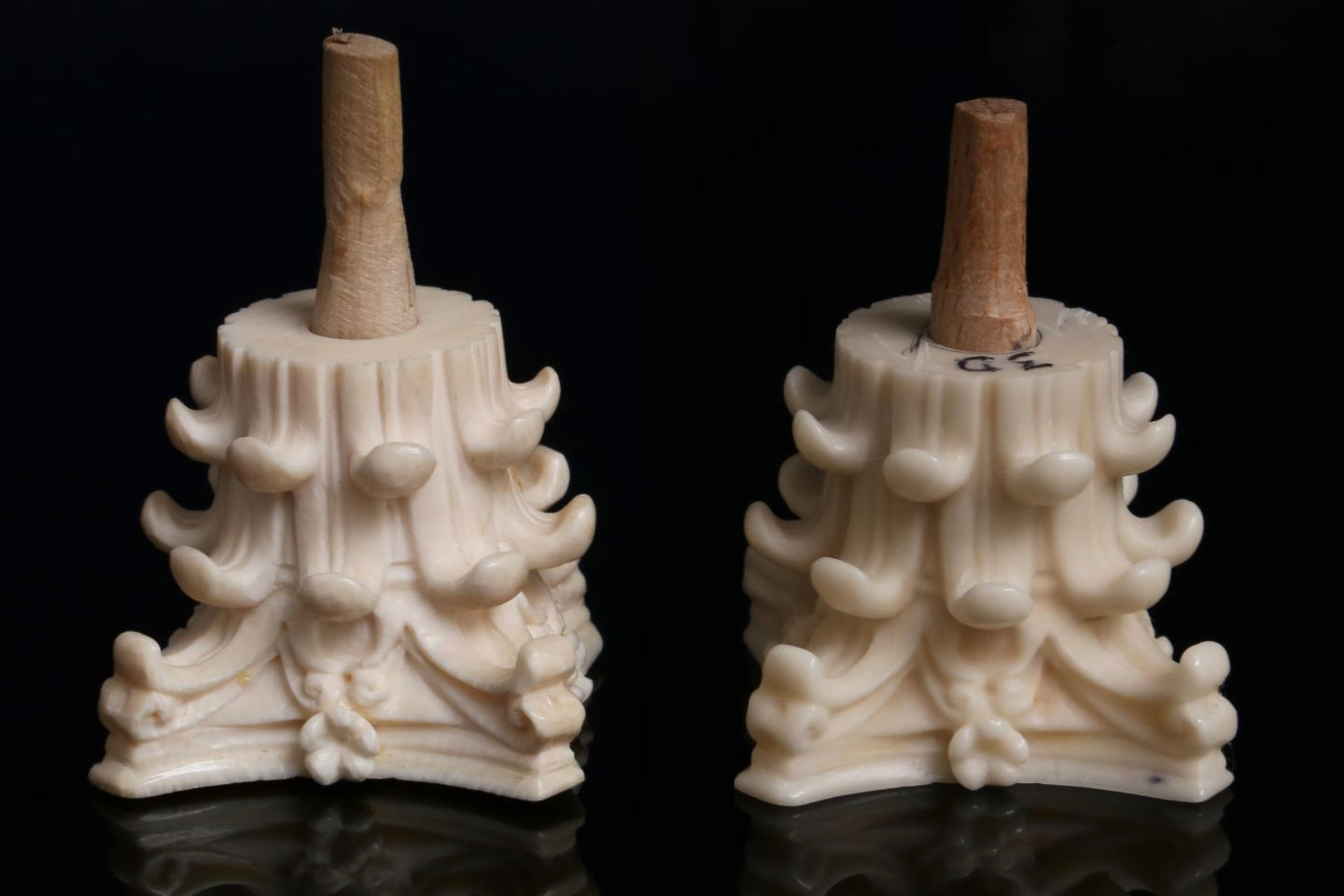 An ivory casket ornament (left) alongside its Digory replica (right)