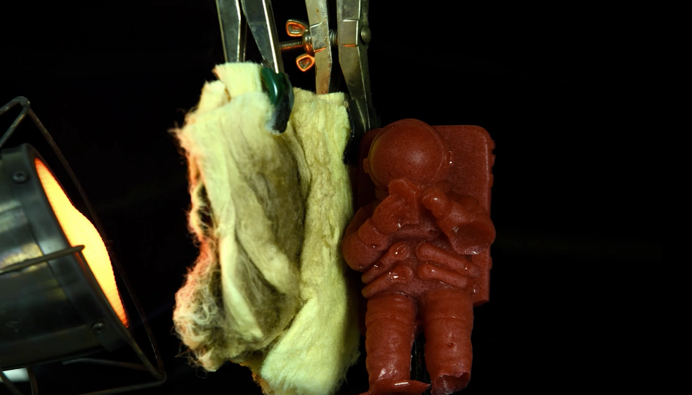 A gelatin astronaut stays unmelted when exposed to a flame, protected by the new nanofiber material