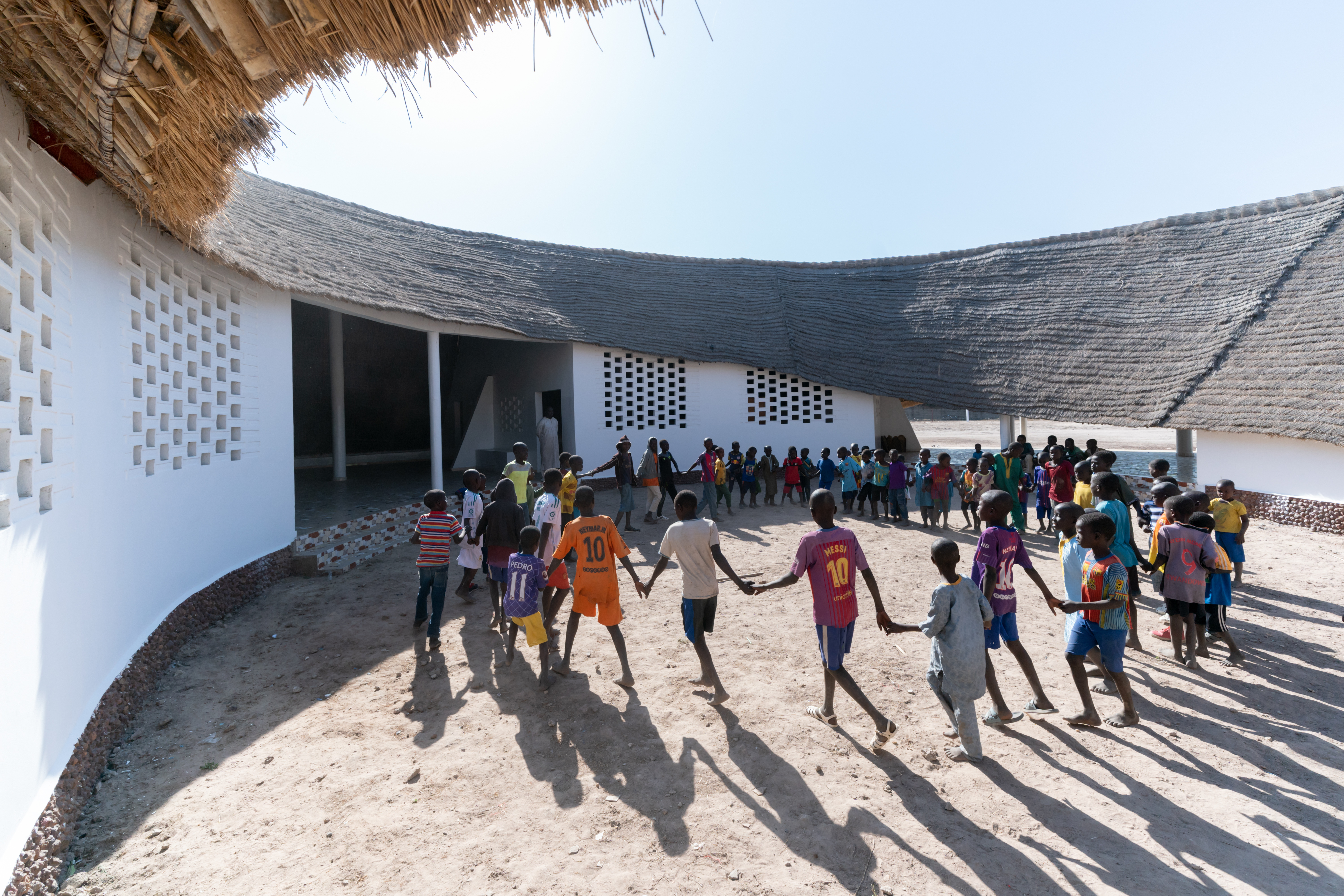 Fass School and Teachers' Residences was designed by Toshiko Mori Architect and is located in Fass, Senegal. The project is one of this year's AIA Architecture Awards winners