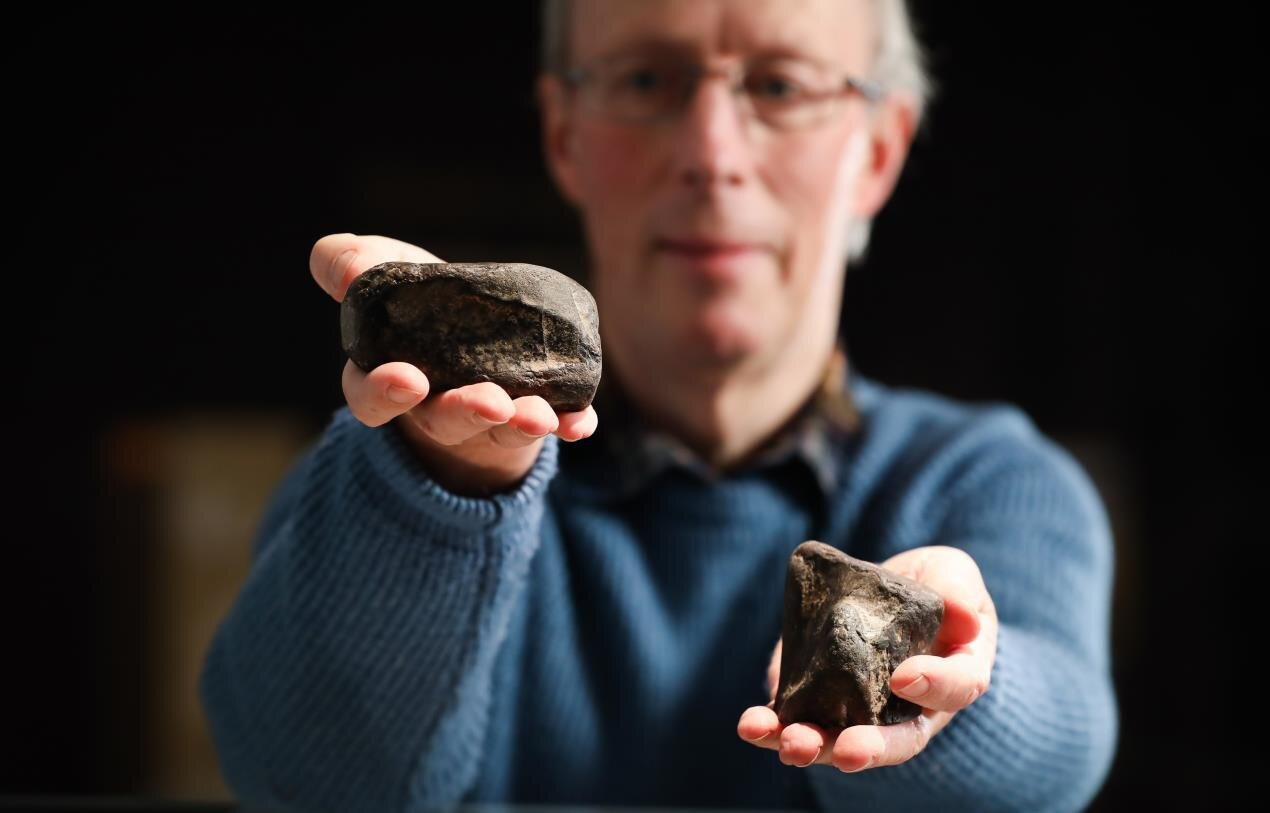 Dr Mike Simms with the theropod tibia (L) and the Scelidosaurus femur (R) found on Ireland