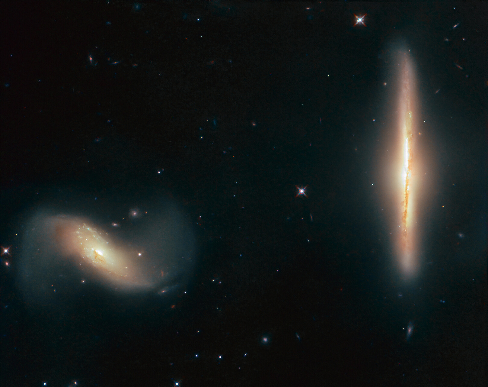 Hubble catches galactic pair locked in a gravitational dance