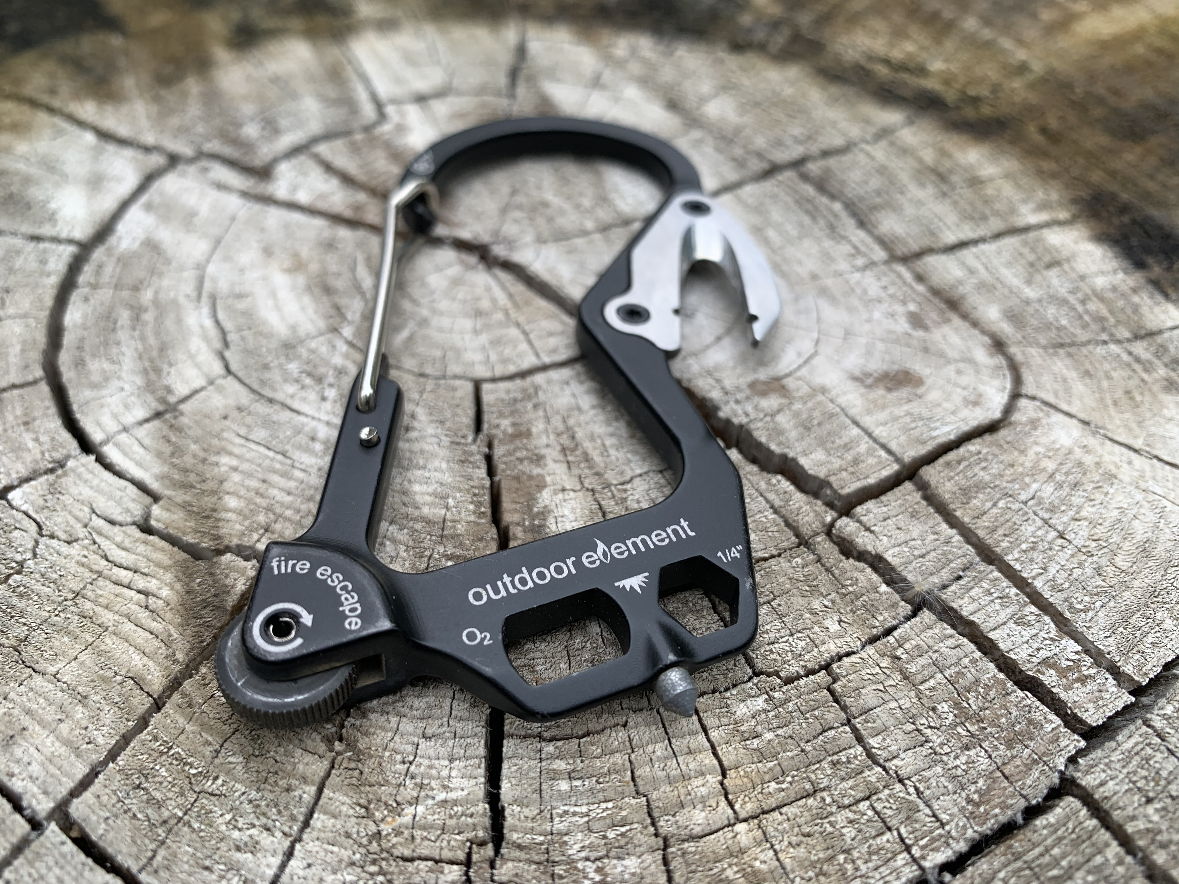 Carabiner multi-tool is made to start fires and perform rescues
