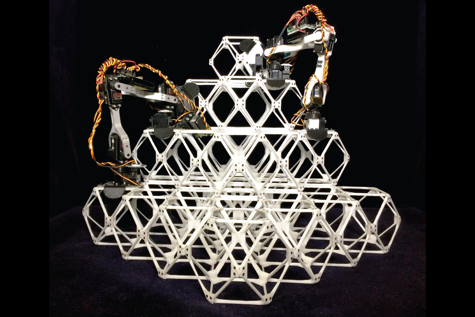 Small assembler robots work together to build large structures