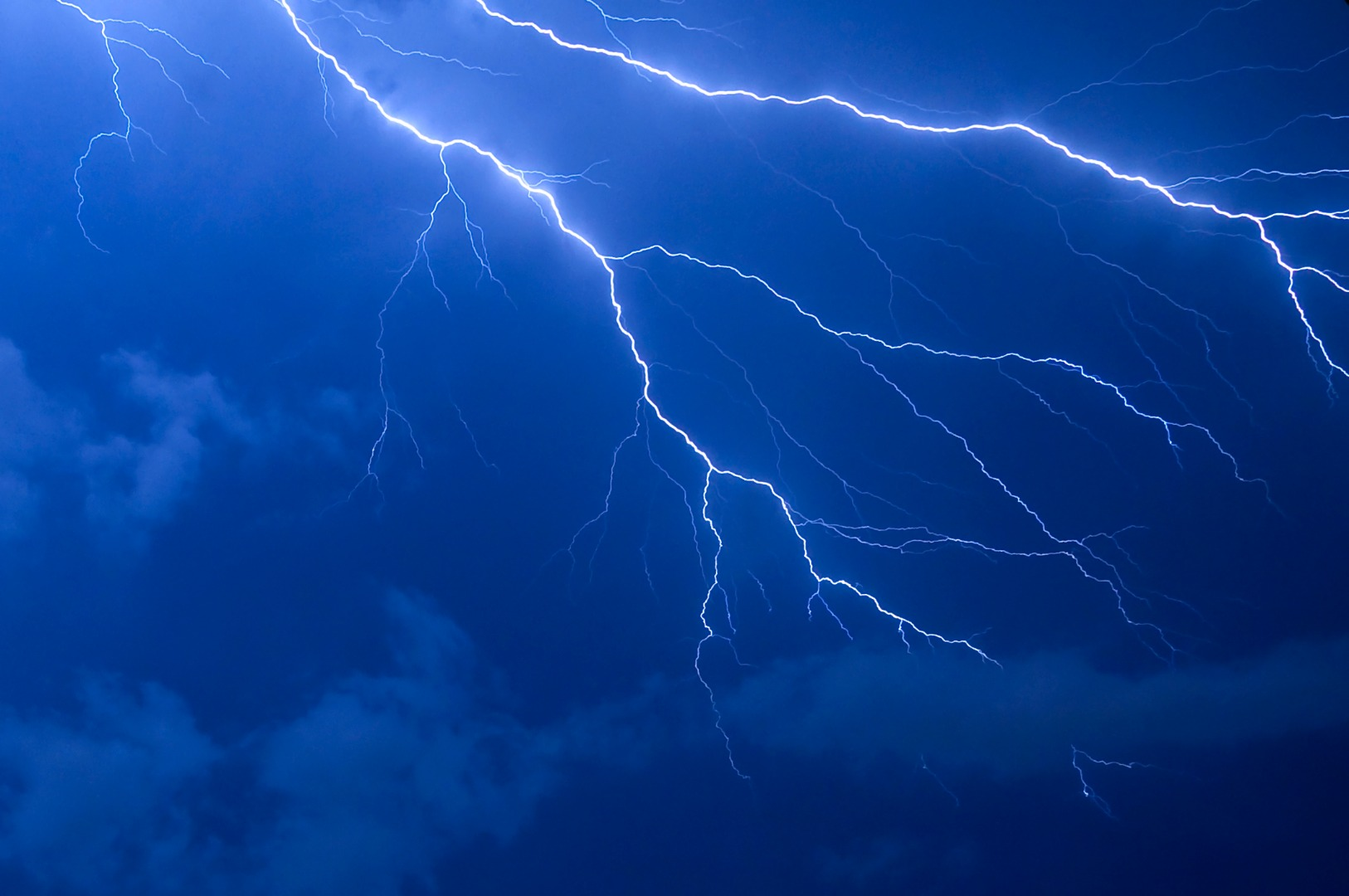 Supernovae-induced lightning may have encouraged humanity's ancestors to walk upright