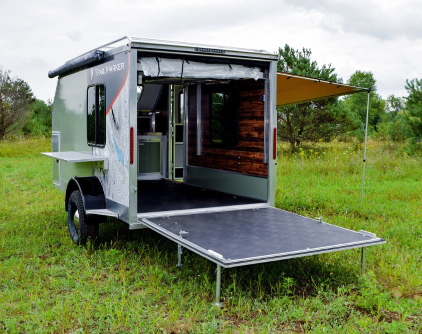 Composite camping trailers blur the line between backcountry lodge and toy-hauling garage