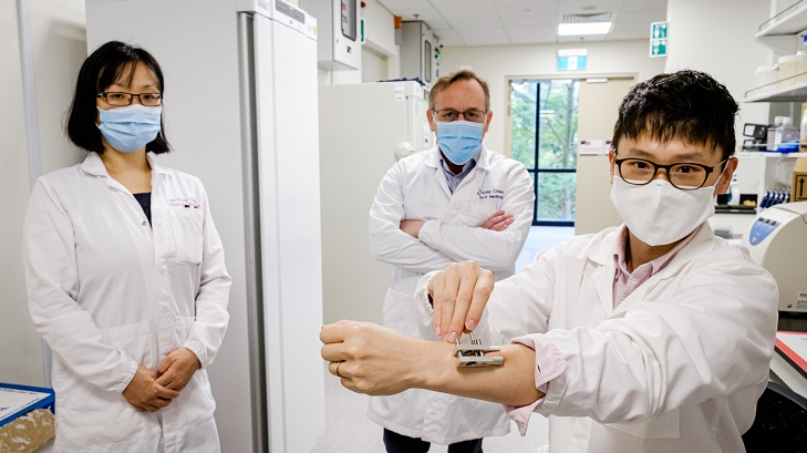 Members of the Nanyang Technological University research team demonstrates their new method of transdermal drug delivery