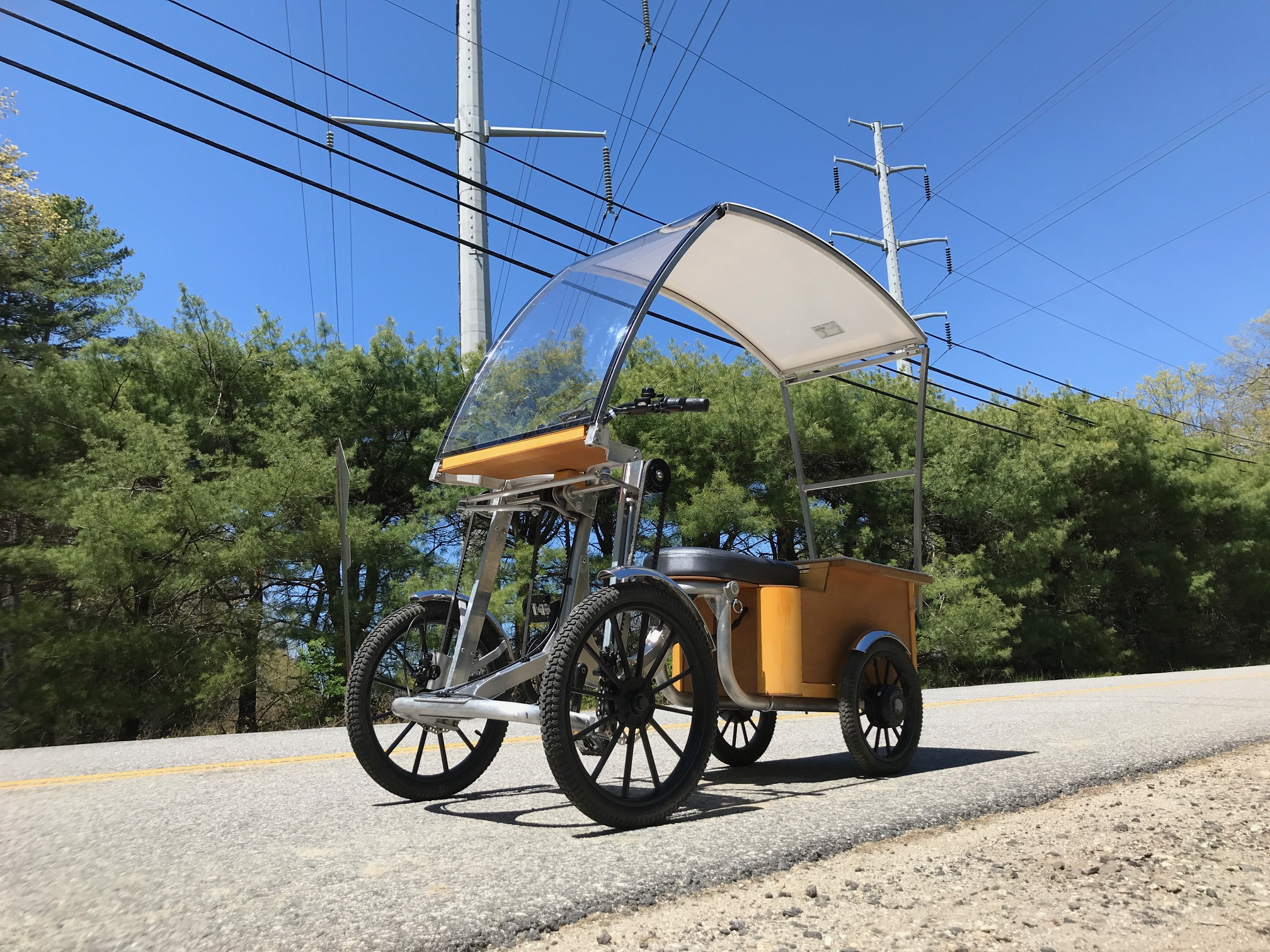 The Screecher four-wheeler features two 350-W rear hub electric motors and a removable Li-ion battery pack that can be charged by the solar panel canopy or via the included AC charger