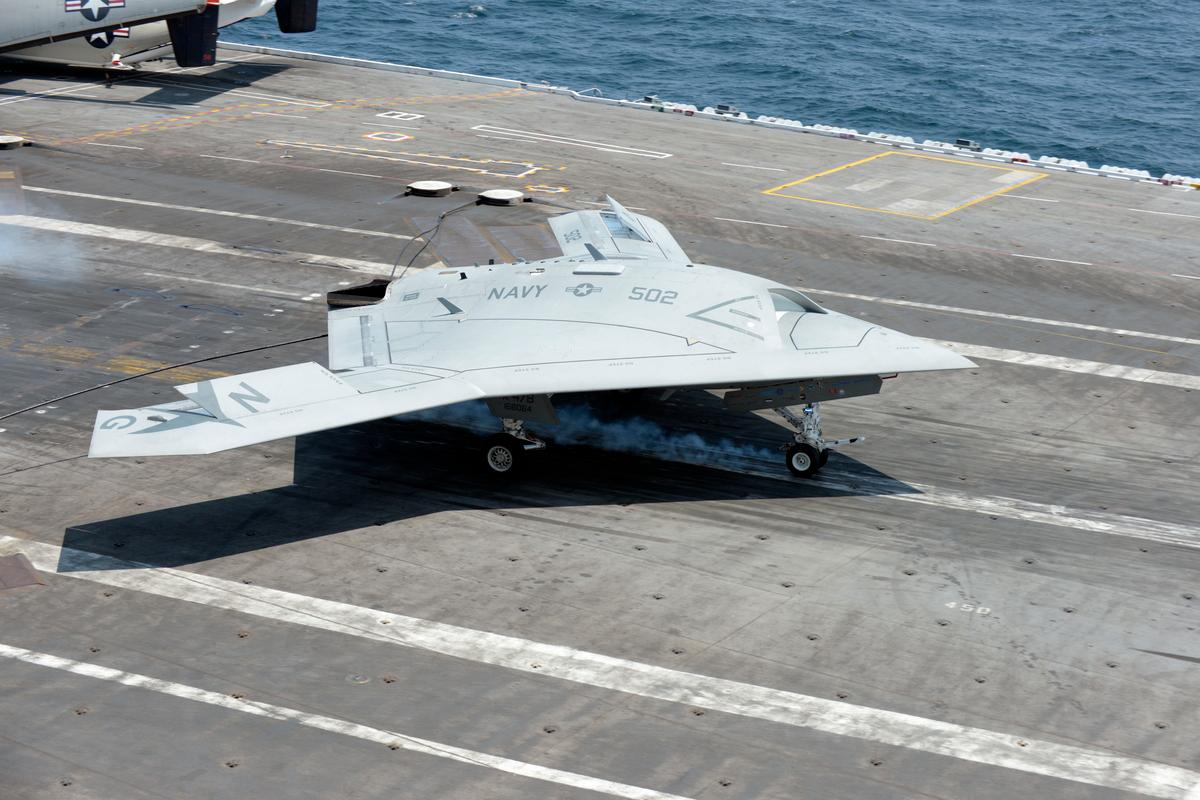 The X-47B making the first UAV arrested carrier landing