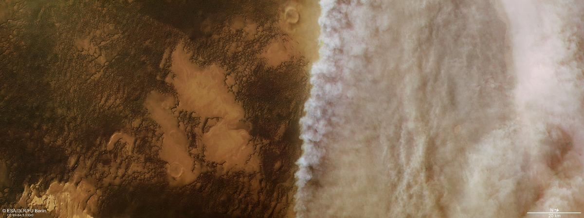 High resolution image fromESA's Mars Express showing dust clouds rolling over the Martian north polar cap