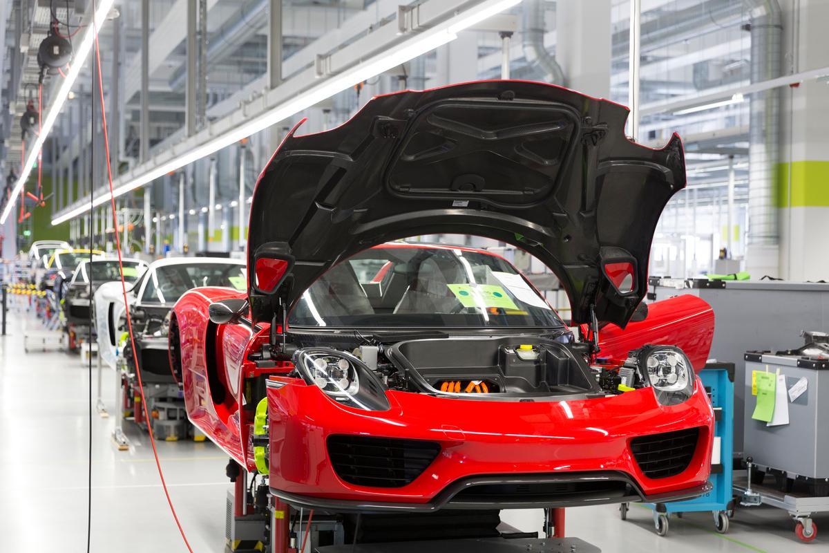 The Porsche 918 Spyder body shell being installed