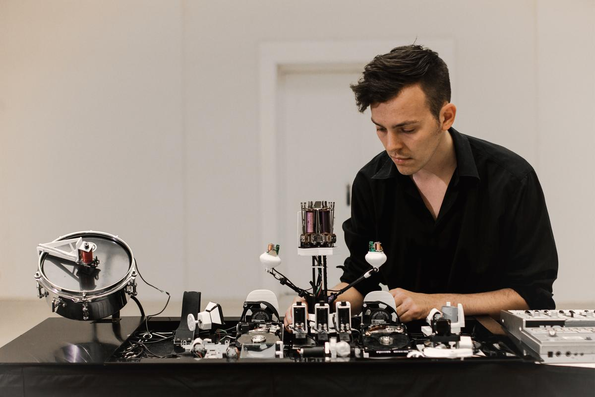 Moritz Simon Geist with some of his techno-playing Sonic Robots
