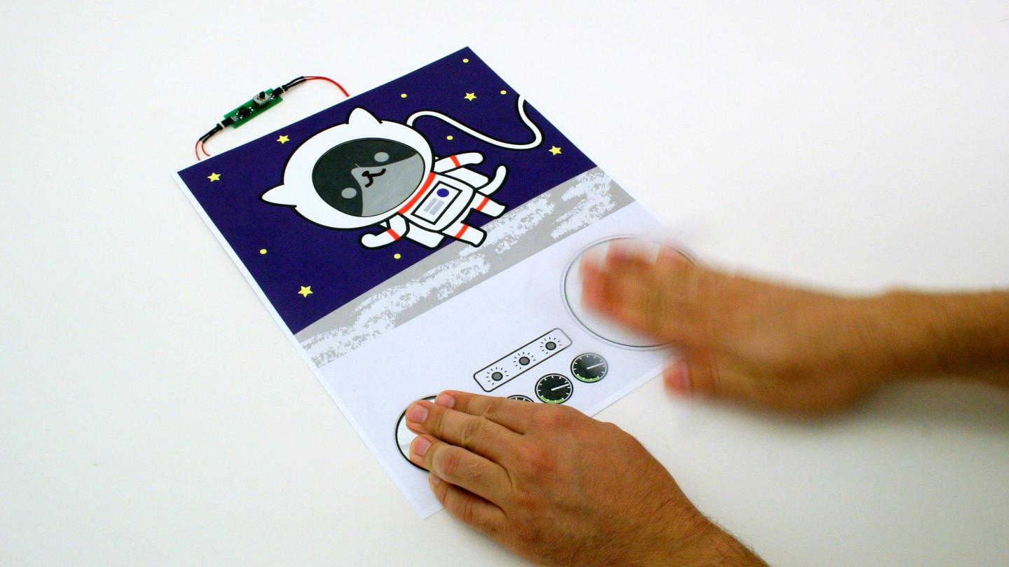 A Paper Generator is used to reveal an astronaut cat's e-ink face
