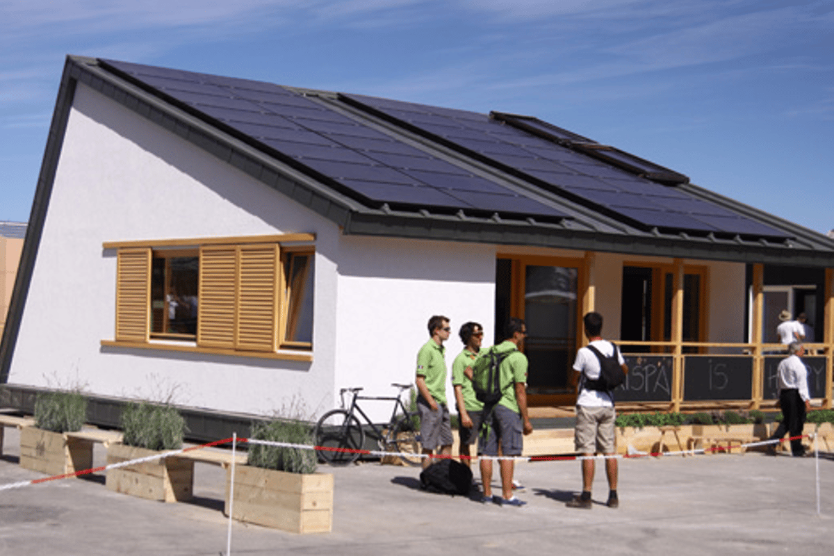 The Romanian Solar Decathlon team, in front of their Prispa home
