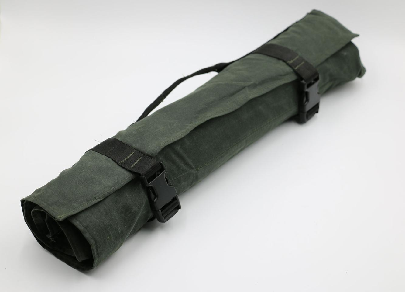 The included roll packs everything into easy carry/store form