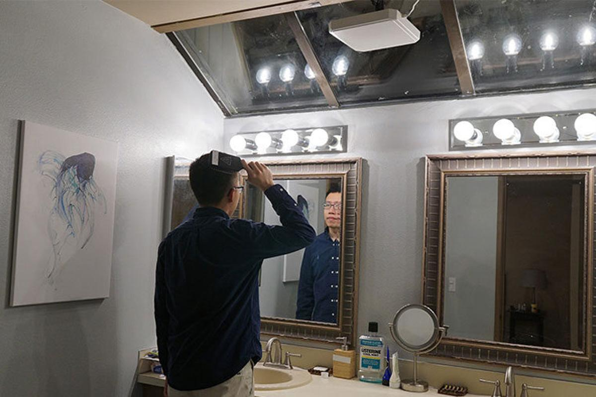 In a test of the system, ceiling-mounted RFIDreaders gather data from RFID tags placed throughout the room