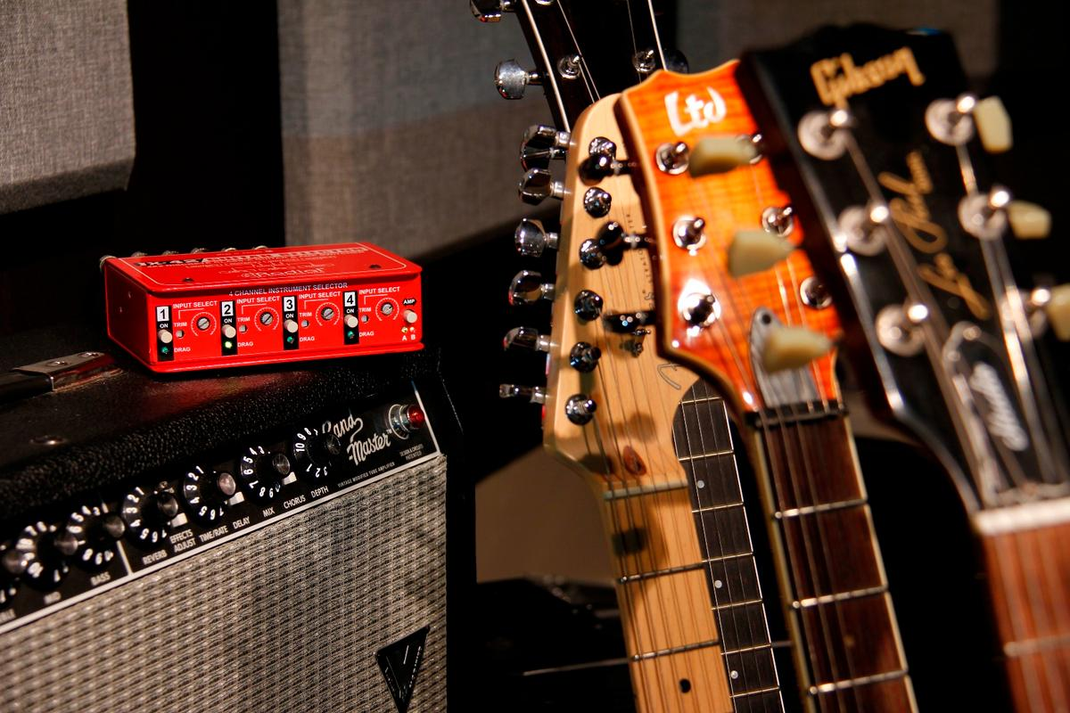 The JX-42 allows players to quietly switch between four guitars and two amplifiers