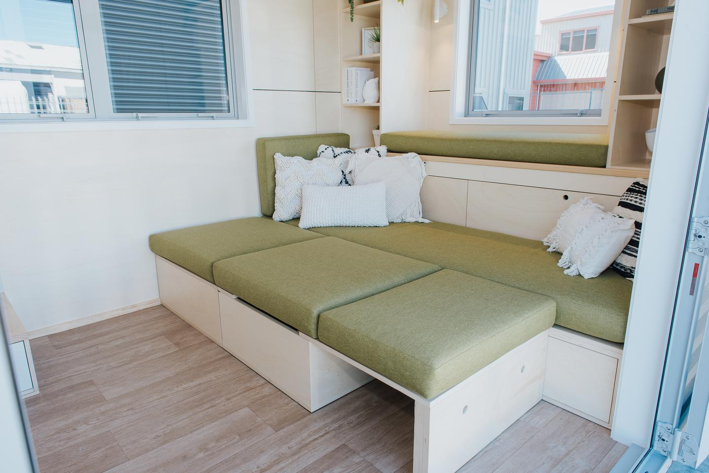 The Wai-Iti Tiny House's sofa converts into a double bed for guests