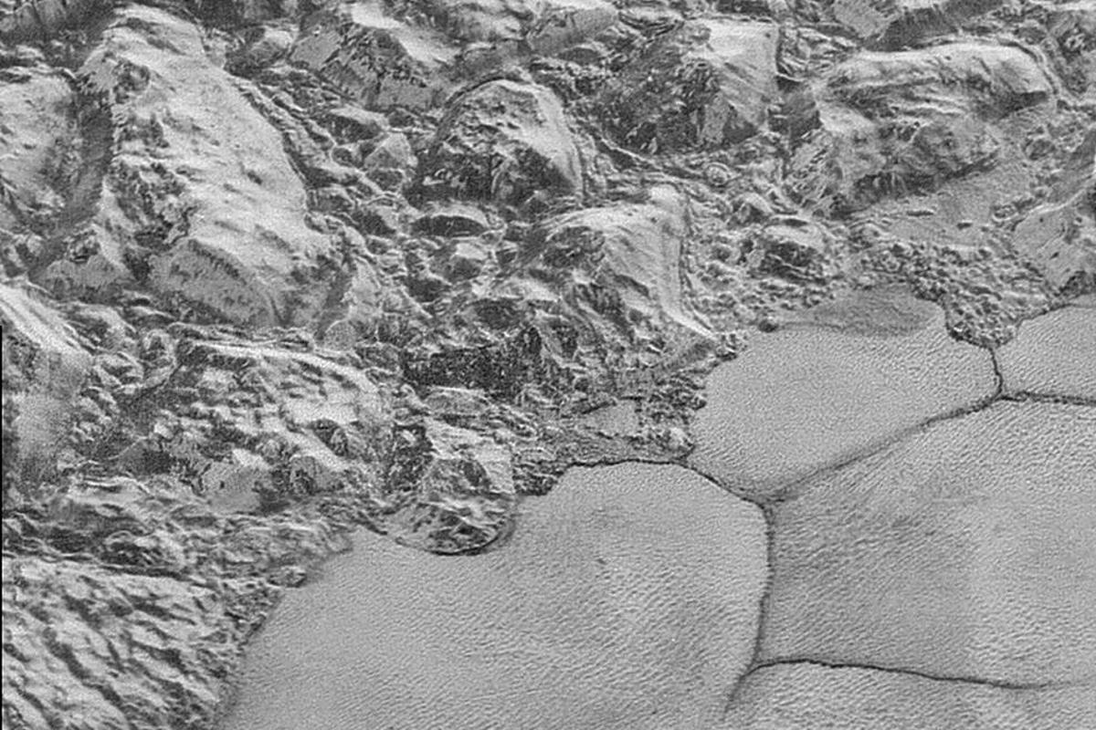 Great chunks of Pluto's water-ice crust appear jammed together in the al-Idrisi mountains