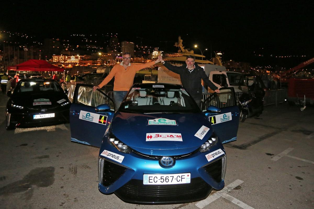 Winning driver Artur Prusak (left) and co-driver Thierry Benchetrit (right) celebrate their victory in the inaugural E-Rally Monte Carlo