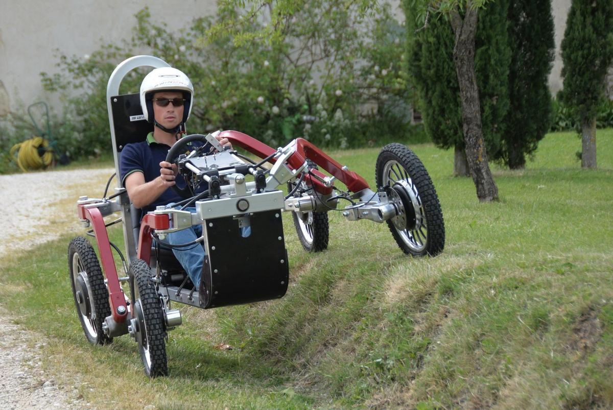Swincar's ridiculous degree of independent suspension freedom allows it to keep a driver upright over some very strange terrain