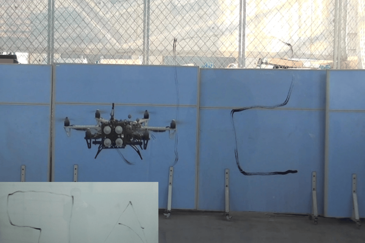 The hexacopter uses a pen in its pressure-sensing arm to write the Shenyang Institute of Automation's initials (SIA) on a glass wall