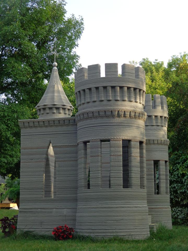 """Andrey Rudenko created the small concrete """"castle"""" using a large 3D printer he built himself"""