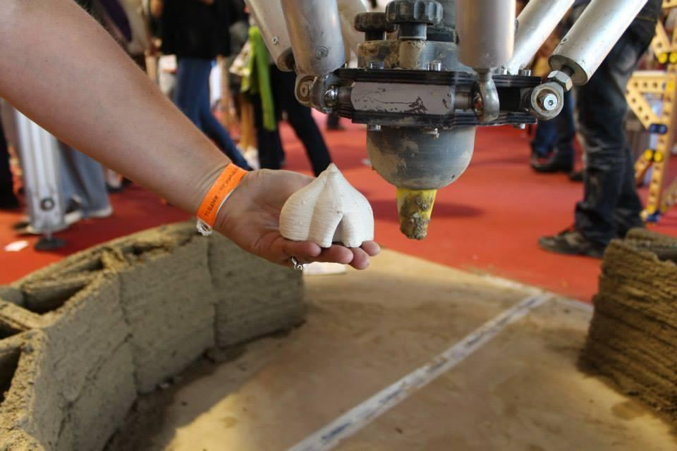 While not a full scale model on show at Maker Faire, at 4 m (13 ft) it was able to produce smaller versions of its mud brick dwellings and serve as a proof-of-concept