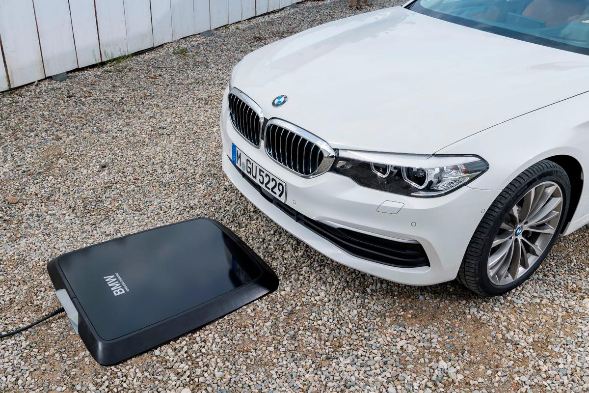 A base pad is placed on the parking space and plugged into the power source – when the vehicle is parked over the top of the pad, inductive charging begins