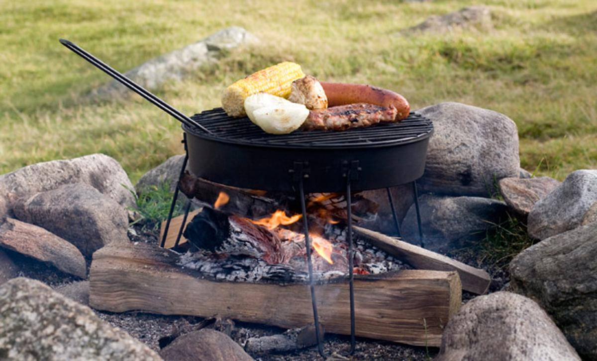 The Pop Up Grill serves as both charcoal grill and campfire grate