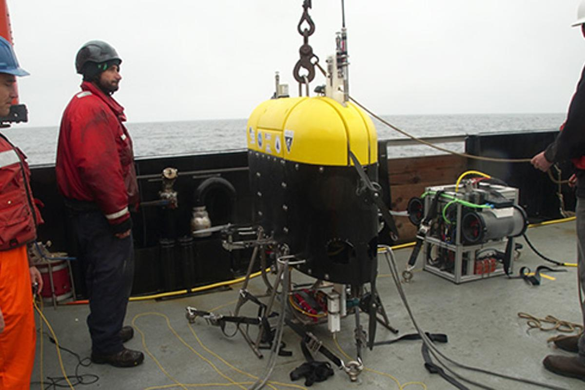 Engineers from Woods Hole Oceanographic Institution and ship's crew on the R/V Rachel Carson prepare to launch the Mesobot into Monterey Bay