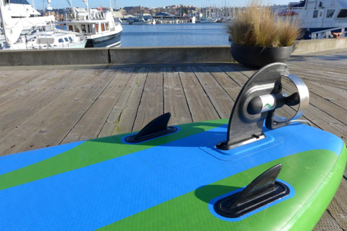 The motorized ElectraFin slides into the existing fin box on stand-up paddleboards