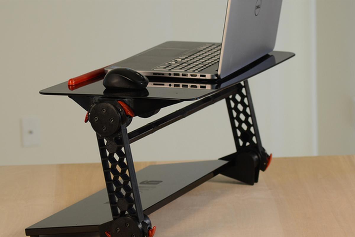 The Torax adjustable desk can be used sitting or standing, and folds up for easy storage