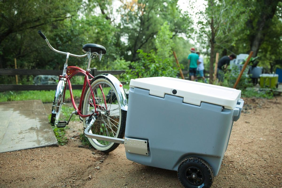 Rovr calls its cooler the first bike-compatible model, but we are aware of at least one otherdesign (multipurpose cooler/grill box) that can be towed this way