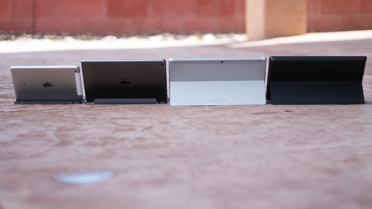 The backsides of (left-right) the Retina iPad mini, iPad Air, Surface 2, and Surface Pro 2