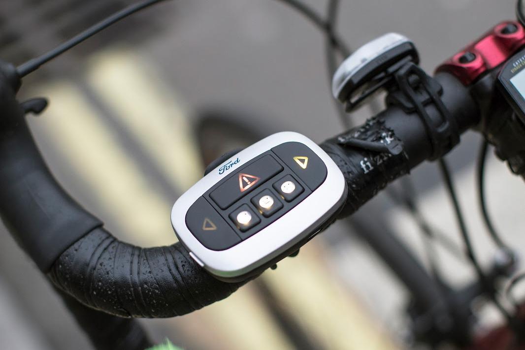 The Emoji Jacket's bar-mounted remote