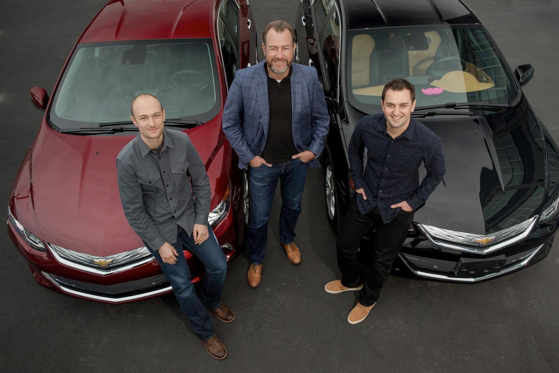 General Motors President Dan Ammann (center) with Lyft Inc. co-founders John Zimmer (right) and Logan Green (left)