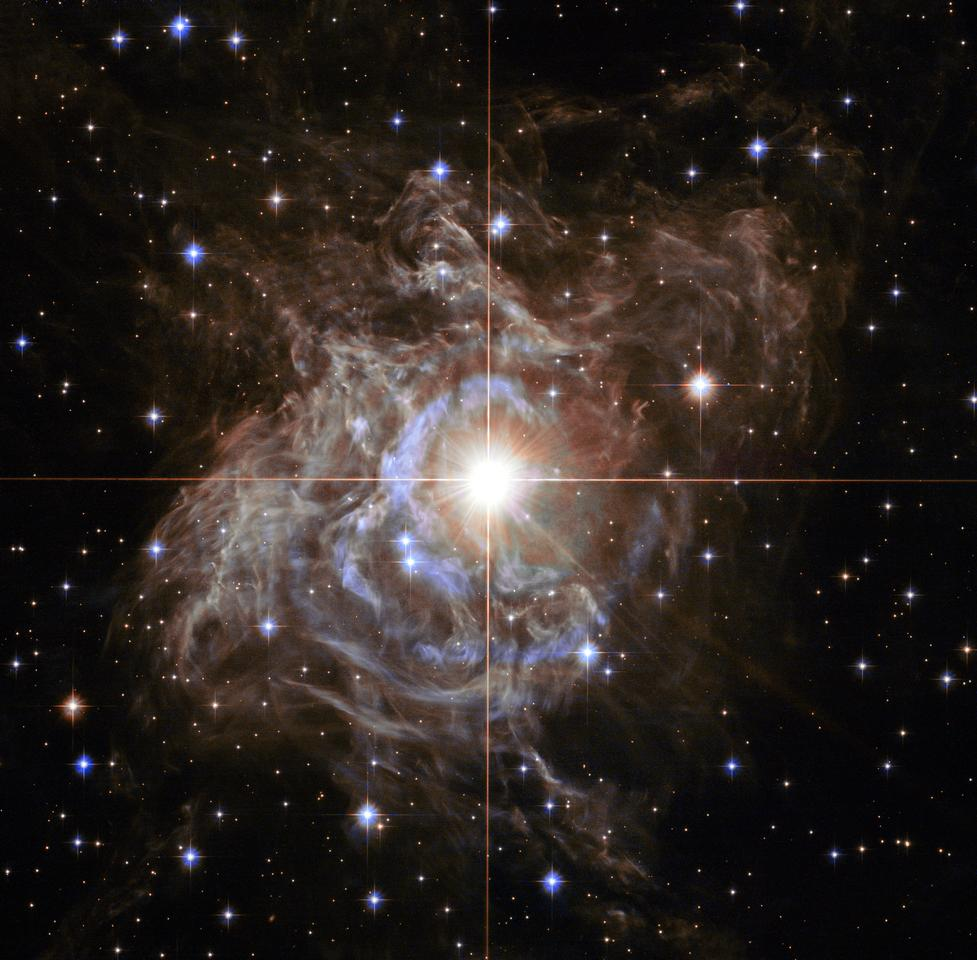 The RS Puppis star, shrouded in colorful reflective dust