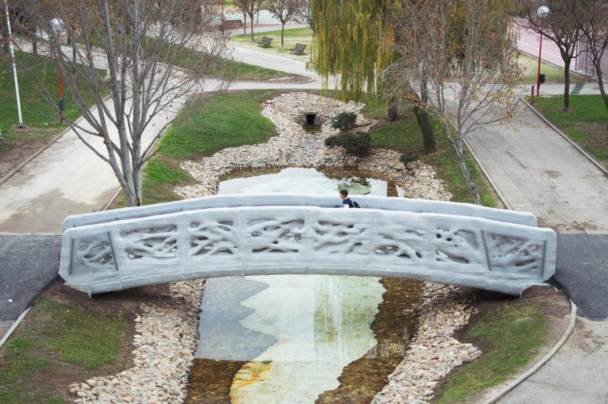 The world's first 3D-printed pedestrian bridge sits in an urban park south of Madrid