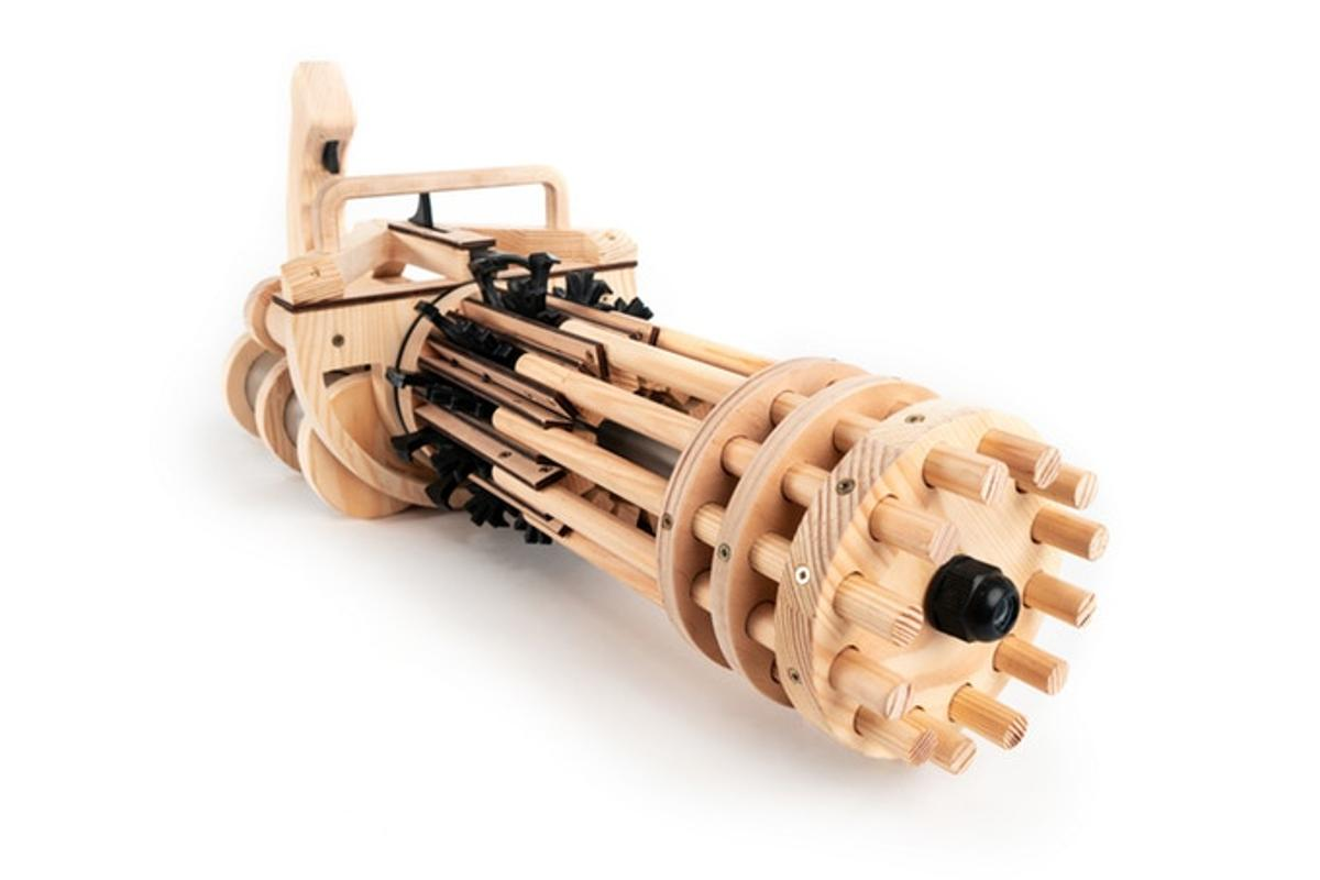 The Rubber Band Minigun is available as a fully assembled toy weapon, or as a DIY kit that arrives with 70 separate pieces