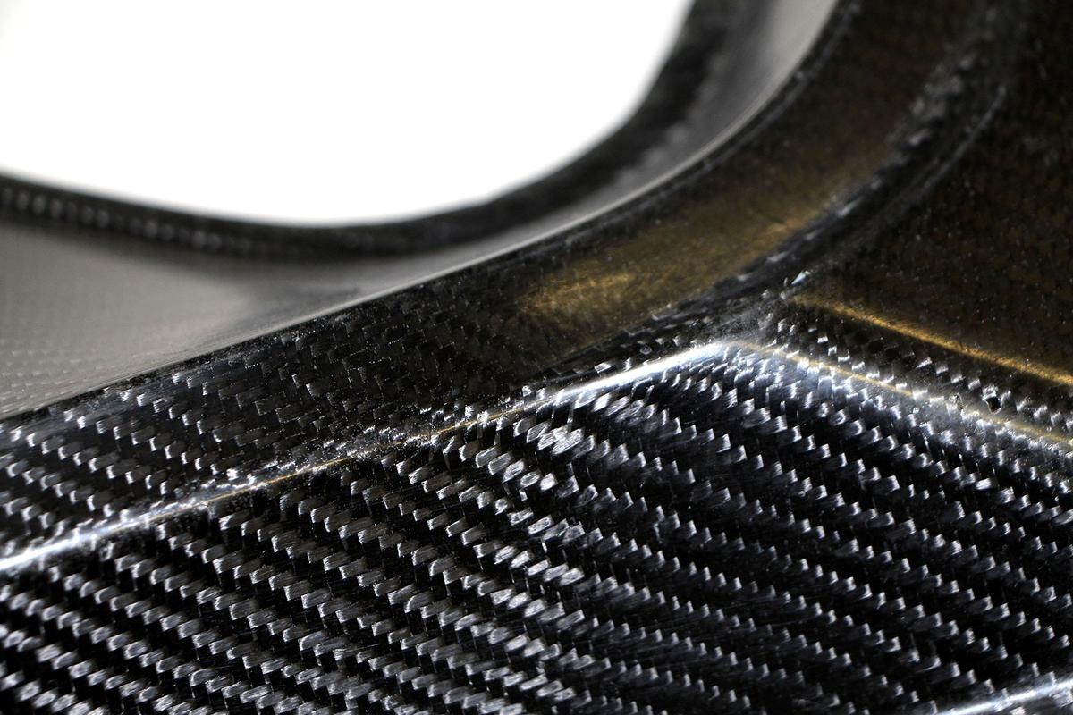 A carbon and hemp-fiber reinforced component such as this is a cheaper, greener hybrid composite that can do the job of pure carbon composites(Image: Fraunhofer)
