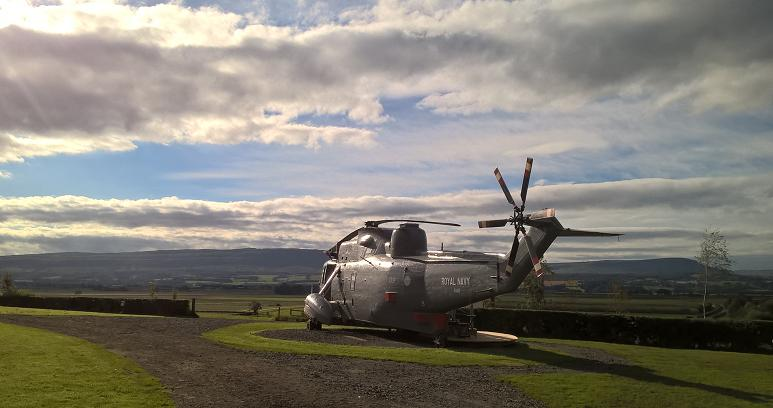 The ex-Royal Navy helicopter was purchased at auction for £7,000 (approx. US $9,100) in March last year, before being transported by road and then craned into its new home on the Mains Farm Wigwams' campsite