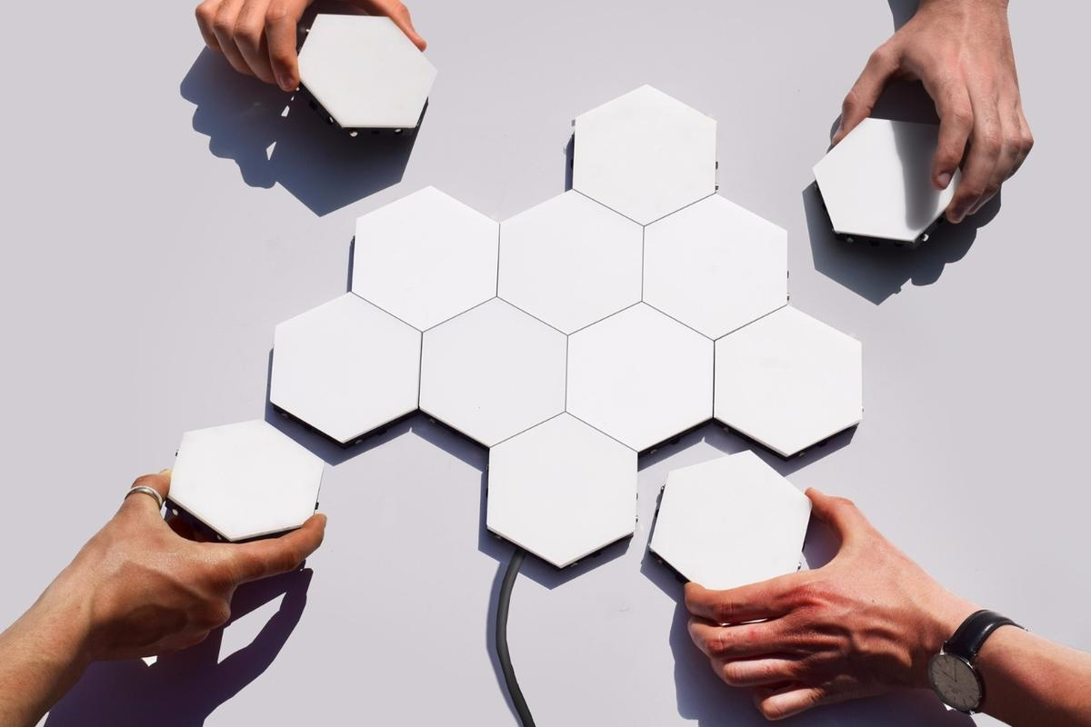 The hexagonal Helios modules are 4.3 in (11 cm) across their longest span and 0.4-in (1-cm) thick