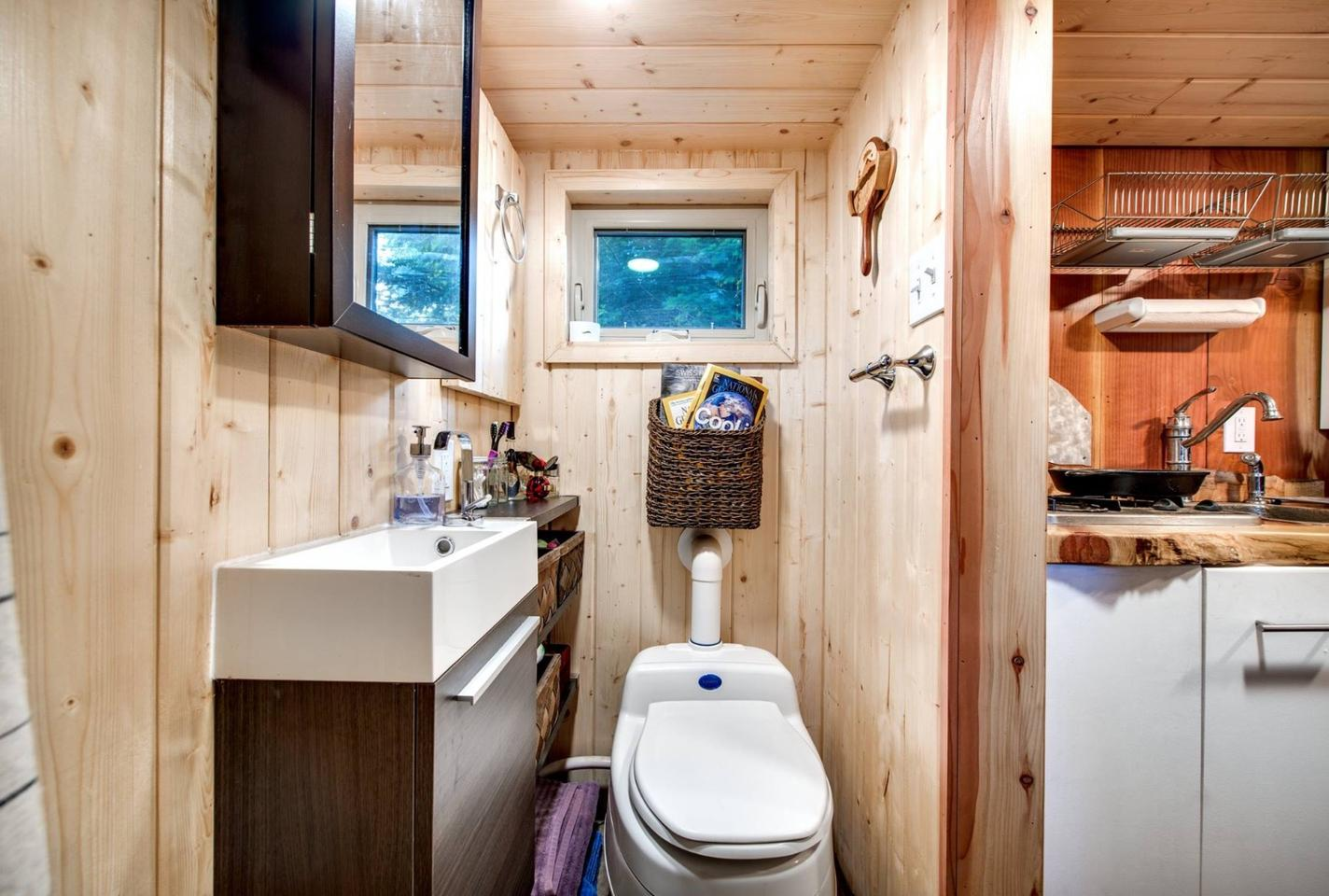 The bathroom includes a composting toilet