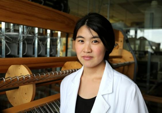 Joanna Ng with the state-of-the-art computer-controlled jacquard loom
