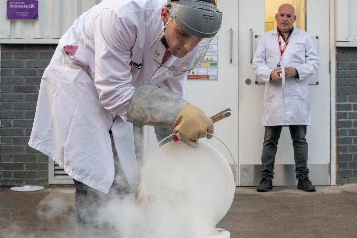 Dr. Thomas Grandjean utilizes liquid nitrogen to freeze a lithium-ion battery