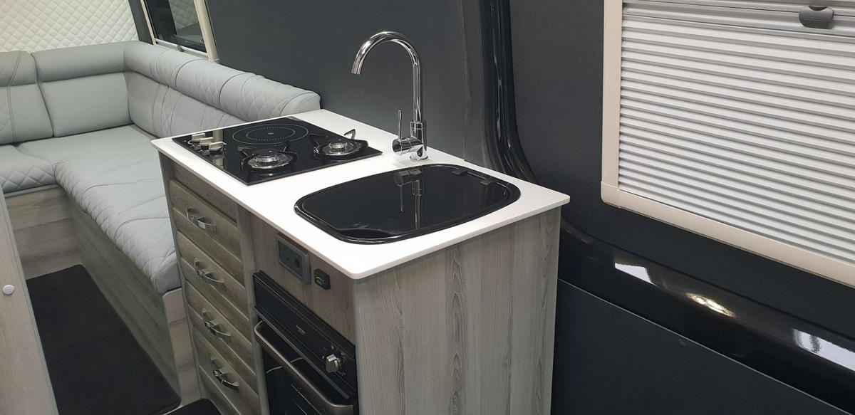 Small but well-equipped, the mainkitchen block includes a hybrid induction/gas stove and an oven/grill