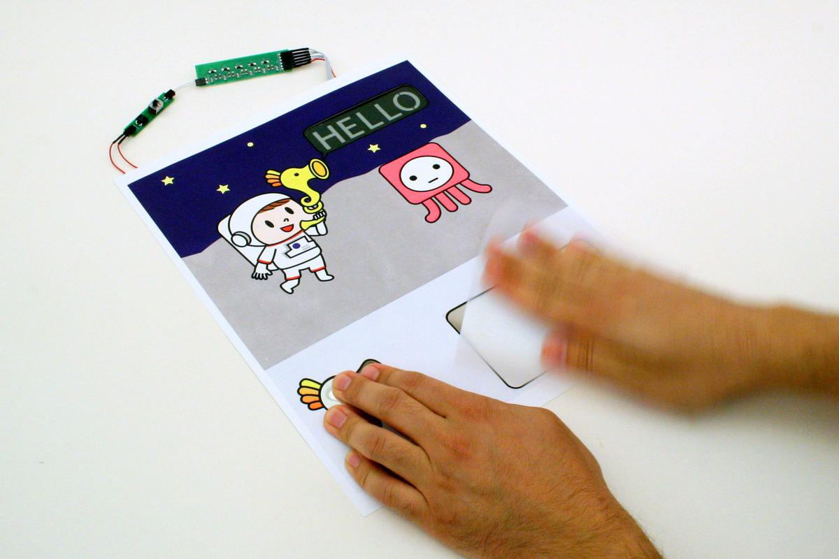 A Paper Generator is used to reveal an e-ink greeting